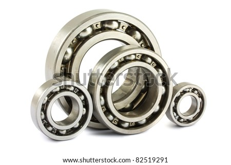 Four steel ball bearings isolated on a white background - stock photo