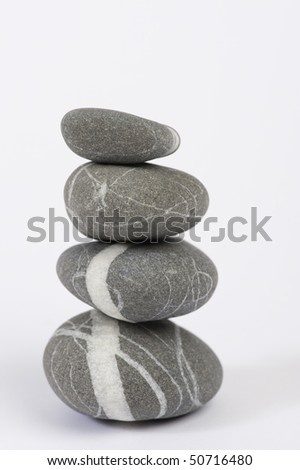 Four stones, isolated on white