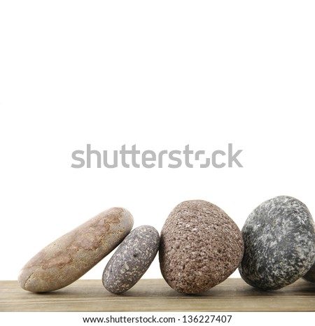 Four stones on a wood board