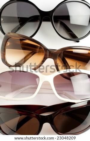 four stylish sunglasses closeup shot - stock photo