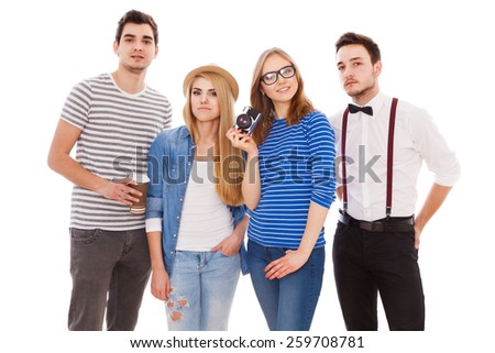Four stylish young people on white background.