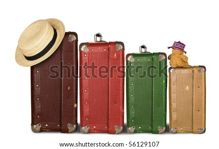 Four Suitcases with Summer Hat and Cuddly Bunny - stock photo