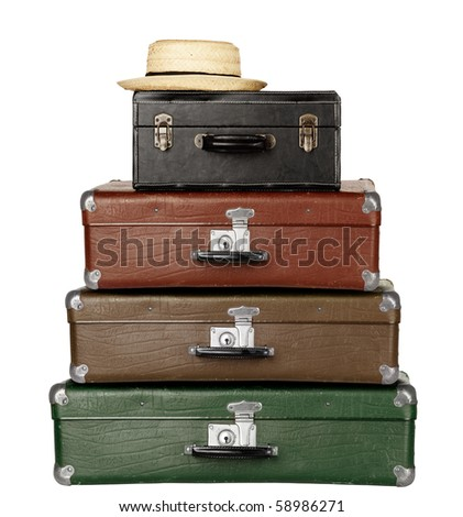 four Suitcases with Summer Hat isolated on white background