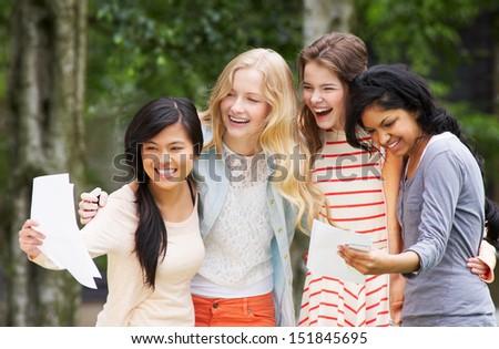 Four Teenage Girls Celebrating Successful Exam Results - stock photo