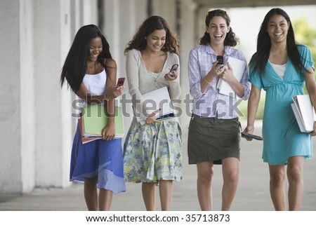 Four teenage girls hanging out in the school campus - stock photo