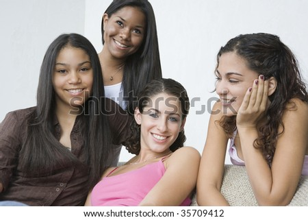 Four teenage girls smiling together - stock photo