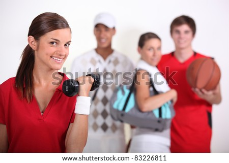 four teenagers loving sport - stock photo
