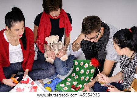 four teens creating gifts - stock photo