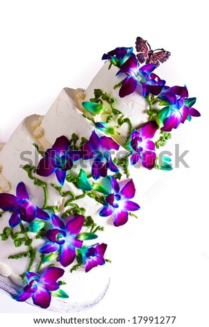 Four tier wedding cake with purple flowers - stock photo