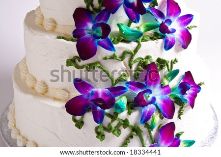 Four tier wedding cake with purple flowers - stock photo