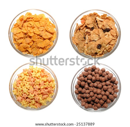 Four transparent bowls with different types of corn flakes - stock photo