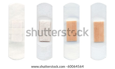Four transparent first-aid plasters isolated on white background. - stock photo