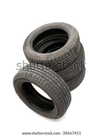 Four tyres isolated on white background - stock photo