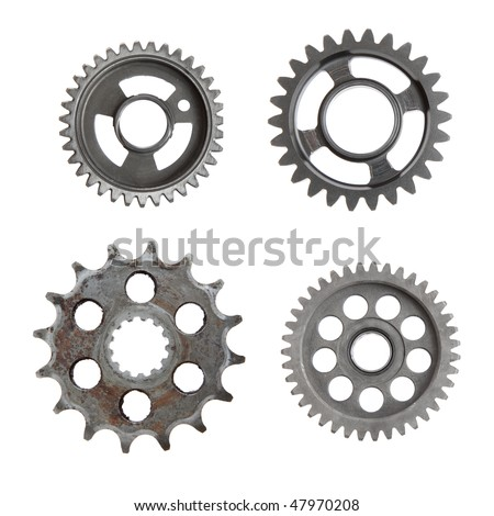 Four unique metal gears on a white background. - stock photo