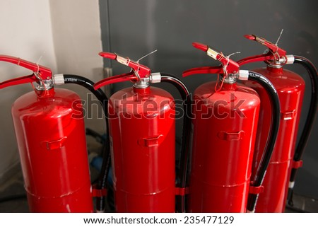 Four units of fire extinguisher - stock photo