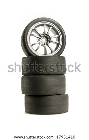 Four used race tires on light background - stock photo