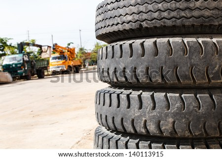 Four used wheel of a crane truck - stock photo