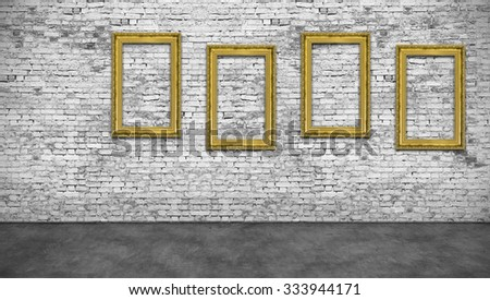 Four vertical golden frames on white brick wall - stock photo