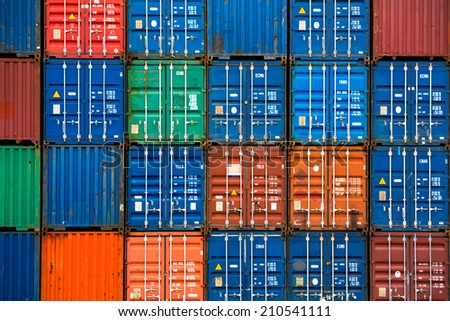 Four vertical rows of shipping containers that are different colors in the Port of Zeebrugge, Belgium - stock photo
