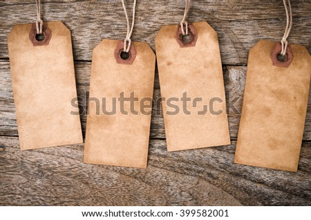 Four vertical Vintage Paper Label on Wood Background - stock photo