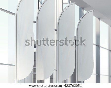 Four vertical wind banners in bright office interior. 3d rendering - stock photo