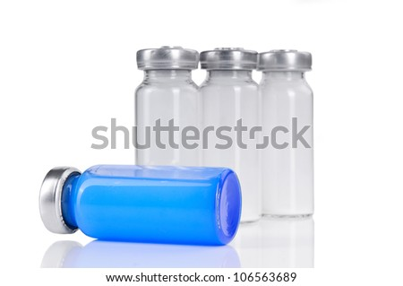 four vials for injection, with white and blue mortar. isolated on a white background - stock photo
