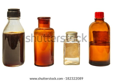 Four vintage medicine bottles isolated on a white background - stock photo