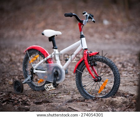 four-wheel child bicycle bicycle in autumn park - stock photo