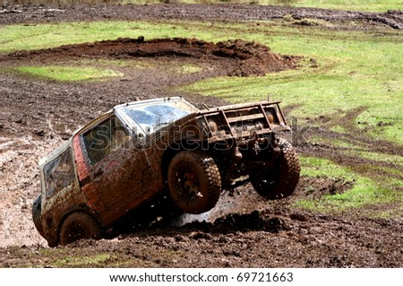 Four wheel drive vehicle bouncing it's way out of a hole - stock photo