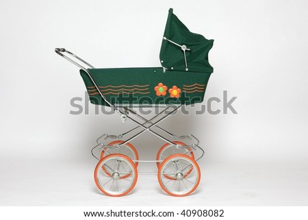 four-wheeled carriage for a baby - stock photo
