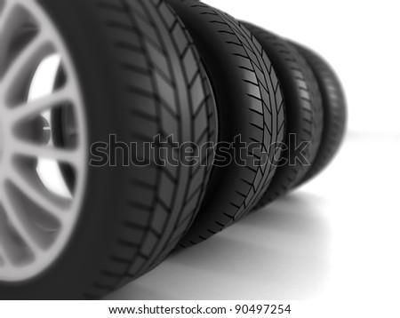 Four Wheels on white Background - stock photo