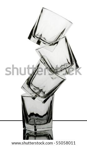 four whisky glasses pyramide - stock photo