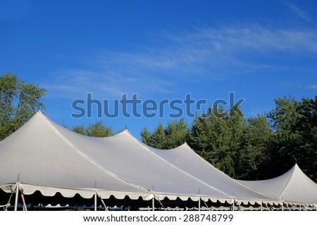 four white giant tent tops peaks - stock photo