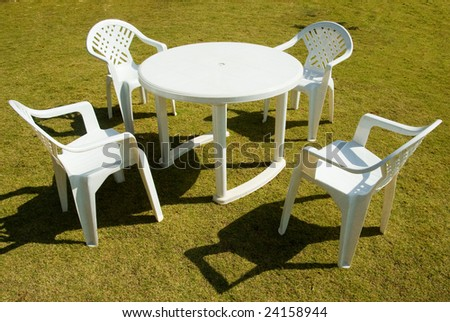 Four white plastic chairs. Plastic Garden Furniture Stock Images  Royalty Free Images