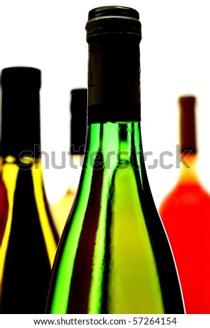 Four wine bottles on a white background. - stock photo