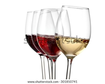 Four wine glasses with bubbles - stock photo