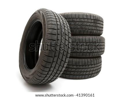 Four winter tyres isolated on white background - stock photo