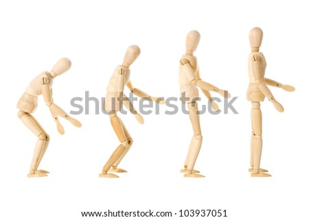 Four wooden dolls with different postures over a white background - stock photo