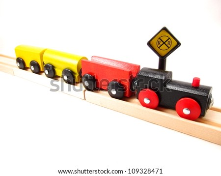 Wooden Train Track Clipart Four wooden toy trains on track with ...