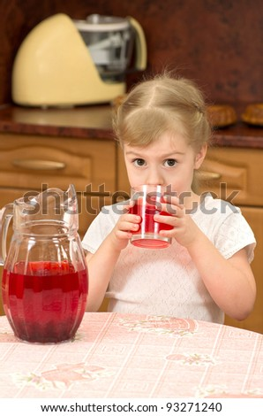 Four-year girl drinking cranberry juice - stock photo
