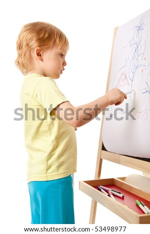 Four-year old boy drawing picture on easel. Over white - stock photo