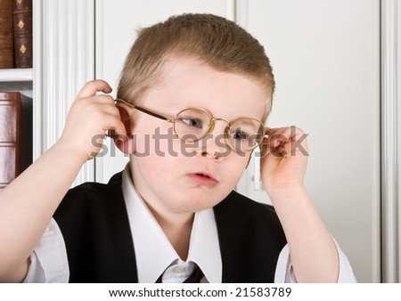 Four year old boy dressed as a director with glasses on