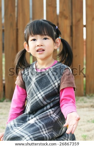 four-year-old girl at back yard - stock photo