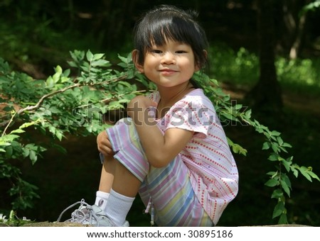four-year-old girl smiling - stock photo