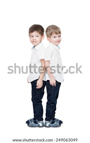 Four-year-old twins boys, in white linen shirts and jeans, to the utmost, isolated on the white - stock photo
