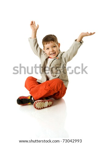 Four years boy sitting on floor isolated on white - stock photo