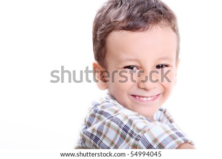 Four years old caucasian boy smiling and looking at the camera. Fun image