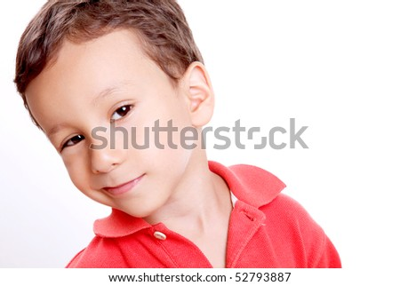 Four years old child, smiling and looking the camera, Space to insert text or design. White background