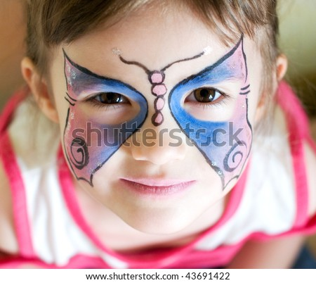 four years old girl with painted face - stock photo