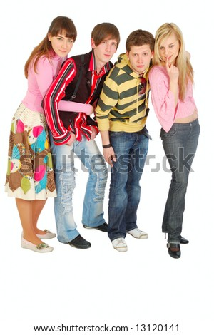 four young adult people strictly looking at the camera. isolated on white